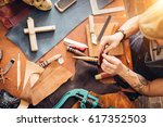 leather craft tools on a wooden ... | Shutterstock . vector #617352503