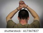 the arrested criminal... | Shutterstock . vector #617367827