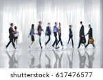 abstract image of people in the ... | Shutterstock . vector #617476577