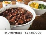 brazilian feijoada food. | Shutterstock . vector #617557703