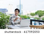 handsome asian young man... | Shutterstock . vector #617592053