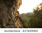 male rock climber with rock... | Shutterstock . vector #617645003