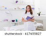 woman beautician doctor at work ... | Shutterstock . vector #617655827