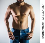Small photo of closeup photo sports guy in jeans with perfect abdominal muscles