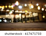 image of wooden table in front... | Shutterstock . vector #617671733