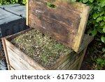 composter in the garden filled... | Shutterstock . vector #617673023
