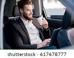 handsome businessman sitting... | Shutterstock . vector #617678777