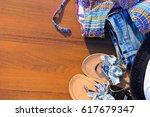 set of beachwear on wooden... | Shutterstock . vector #617679347