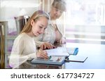 10 years old girl and her...   Shutterstock . vector #617734727