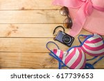 bikini glasses hat camera on... | Shutterstock . vector #617739653