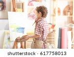 cute little artist painting... | Shutterstock . vector #617758013