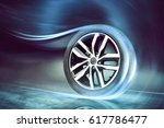 Small photo of Dynamic car tire on the road