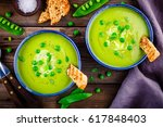 green pea soup with croutons on ... | Shutterstock . vector #617848403