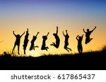 silhouettes of young group of...