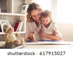 beautiful business mom in suit... | Shutterstock . vector #617915027