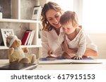 beautiful business mom in suit... | Shutterstock . vector #617915153