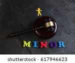 gavel with minor spelled out... | Shutterstock . vector #617946623
