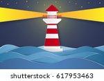 lighthouse at night   paper art ... | Shutterstock .eps vector #617953463