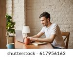 attractive student use internet ... | Shutterstock . vector #617956163