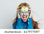 the woman closed her ears and... | Shutterstock . vector #617977097