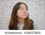 Small photo of Young asian women feel bored with what they see every day, she don't want to talk anymore, boring concept