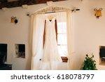 the bride's dress hangs on the... | Shutterstock . vector #618078797