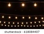 garlands of lamps on a wooden... | Shutterstock . vector #618084407