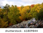 Photograph of an area of rock slide in a state park on Rib Mountain in north-central Wisconsin.  Taken during the peak of the autumn season with beautiful vibrant colors.