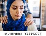 muslim woman beign herrased by...   Shutterstock . vector #618143777