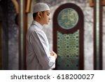 muslim man praying in mosque | Shutterstock . vector #618200027