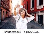 happy young female traveler... | Shutterstock . vector #618290633