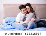young family with pregnant wife ...   Shutterstock . vector #618316997