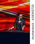 young dj in nightclub | Shutterstock . vector #618343733