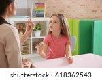 young woman teacher and little... | Shutterstock . vector #618362543
