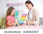 young woman teacher and little... | Shutterstock . vector #618362567