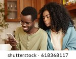 obsessed possessive young afro...   Shutterstock . vector #618368117