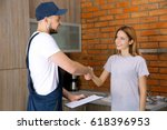 plumber and woman shaking hands ... | Shutterstock . vector #618396953