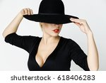 mysterious girl in a black... | Shutterstock . vector #618406283