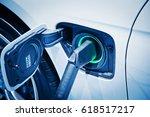 charging an electric car battery | Shutterstock . vector #618517217