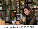 asian woman drinking coffee  ... | Shutterstock . vector #618539687