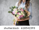 florist at work  pretty young...   Shutterstock . vector #618542393