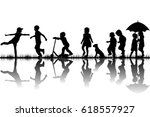 silhouettes of children playing ... | Shutterstock .eps vector #618557927
