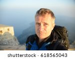 a man on top of mount athos in...