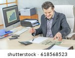 a businessman looks very happy... | Shutterstock . vector #618568523
