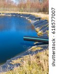 Small photo of Landfill leachate pouring into pond from a black and blue pipe. Location Ronneby, Sweden.