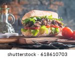 beef sandwich with tomato and... | Shutterstock . vector #618610703