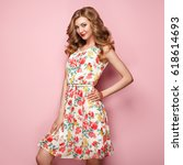blonde young woman in floral... | Shutterstock . vector #618614693