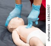 cpr training on baby dummy... | Shutterstock . vector #618620507