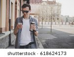 young hipster man walking on... | Shutterstock . vector #618624173