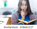 girl student reads a book at... | Shutterstock . vector #618661127